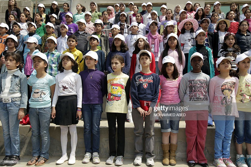 Children of the UNRWA schools sing during a training session ahead of their performance in the 'al-Sununu' choir concert on April 19, 2013 in Gaza City. The Elena Rostropovich association in cooperation with notably UNRWA organizes next week the 'al-Sununu' (the swallow) concert involving a total of 23 choirs are involved (from West Bank, Gaza, Jordan, Syria and Lebanon), all being linked via satellite.