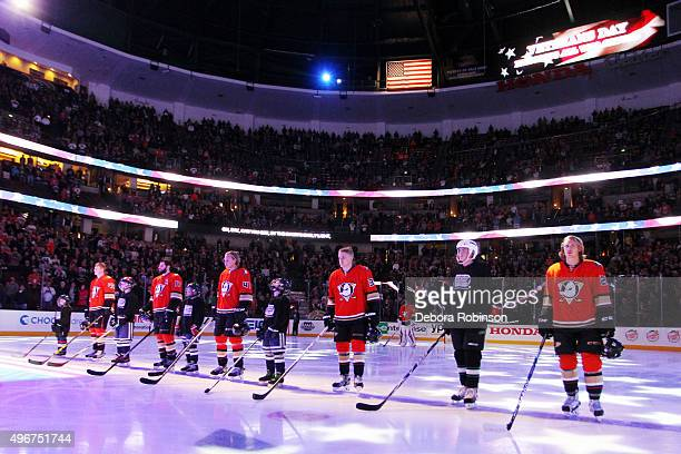 Children of US military veterans stand with the Anaheim Ducks starting lineup during the national anthem before the game against the Edmonton Oilers...