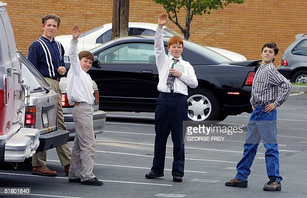 Children of Utah polygamist Tom Green showoff for photographers as they leave the court house at the end of the second day of court in Provo Utah...