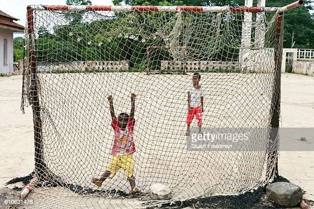 Children of workers play football at the restored Roca Boa Vista Sao Tome Sao Tome and Principe are two islands of volcanic origin lying off the...