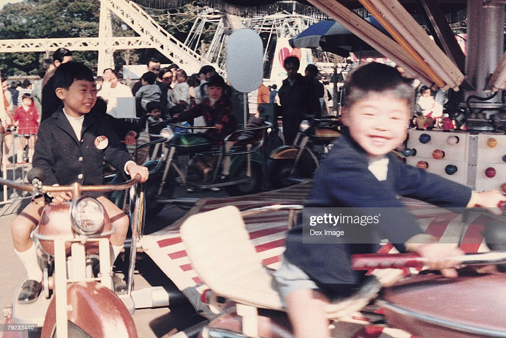 Children on a amusement car ride : Stock Photo