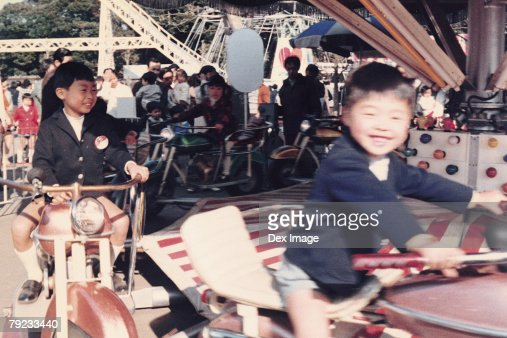 Children on a amusement car ride : Stock Photo