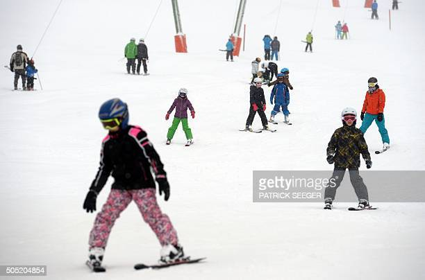 Children on skis make their way through the snow on a hill near Muggenbrunn southern Germany on January 16 2016 / AFP / dpa / Patrick Seeger /...