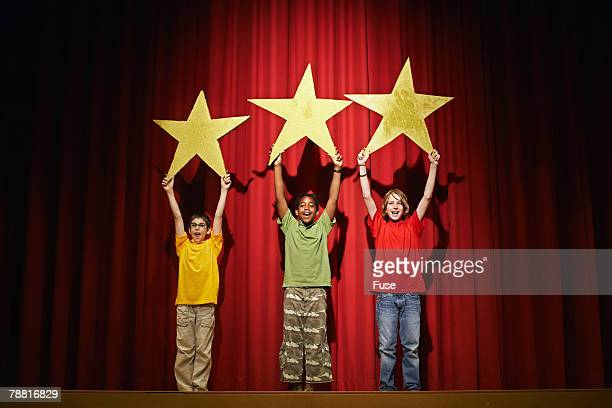 Children on Stage Holding Stars