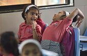 Children on the first day of school at Mira Road on June 15 2016 in Mumbai India Attired in brandnew uniforms the children turned up at their...
