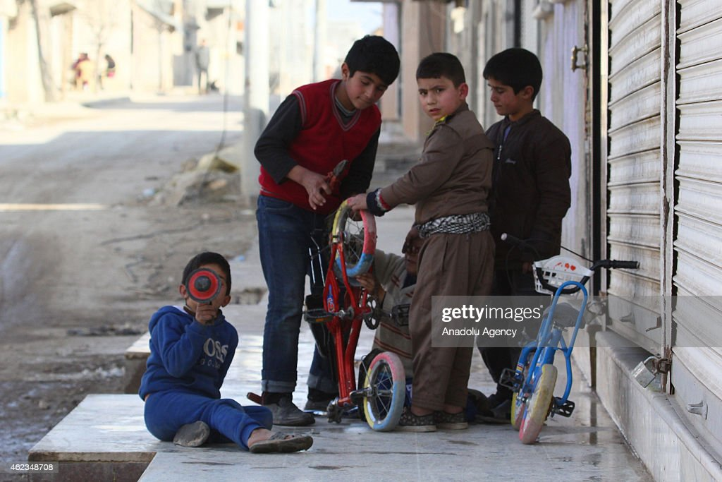Children on the street in Kobani, Syria on January 27, 2015 after it has been freed from Islamic State of Iraq and the Levant (ISIL).