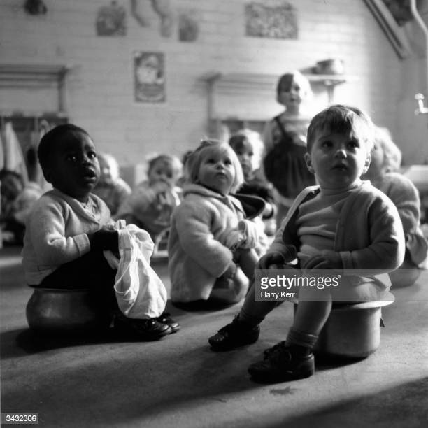 Children on their potties at a day nursery in Brixton south east London