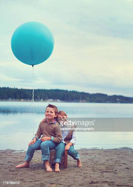Children on with a big blue balloon