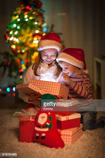 Children opening their Christmas gifts