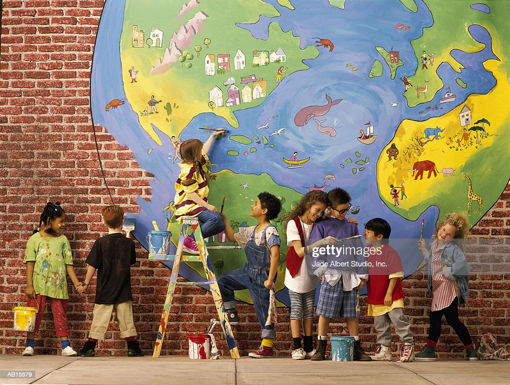 Children (5-7) painting an earth mural : Stock Photo