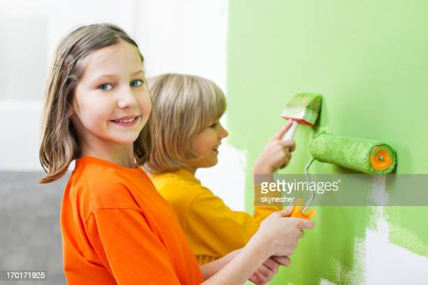 Children painting the wall