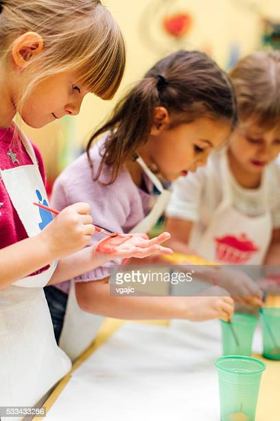 Children Painting Their Hands With Watercolors