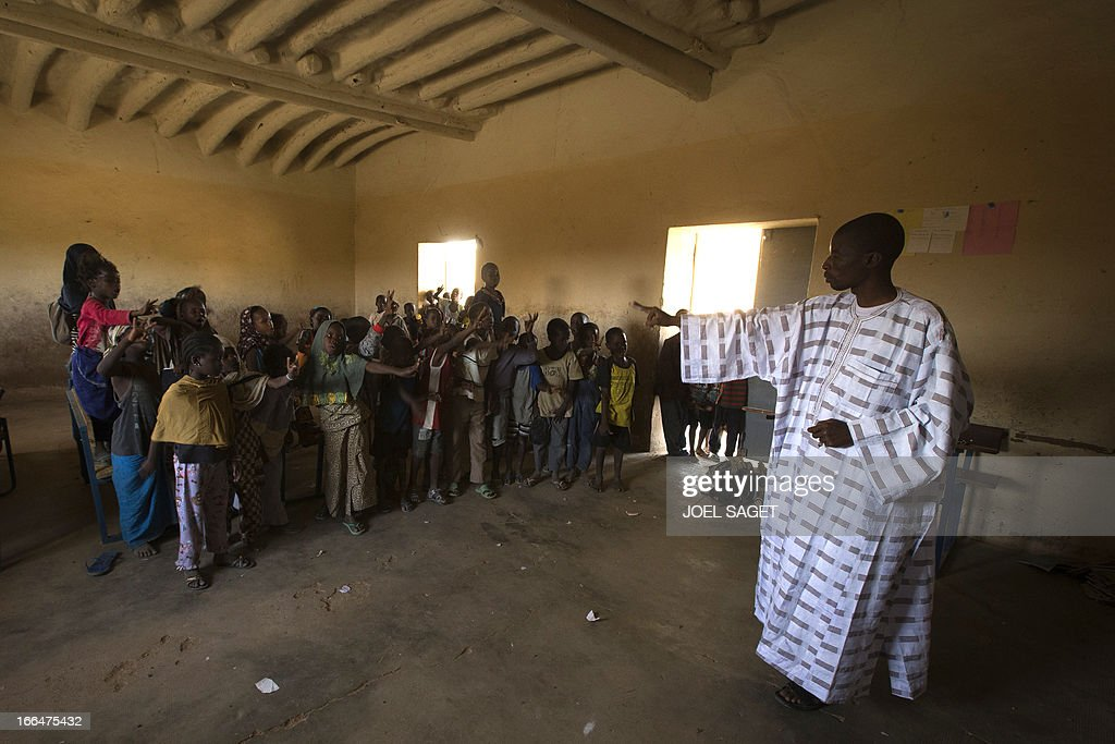 Children participate during a lesson with teacher Isaika Maiga (R) at Thionville Chateau school in Gao, Mali on April 12, 2013.