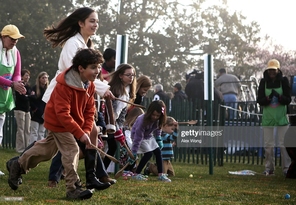 Children participate during the annual White House Easter Egg Roll on the South Lawn of the White House April 1 2013 in Washington DC US President...
