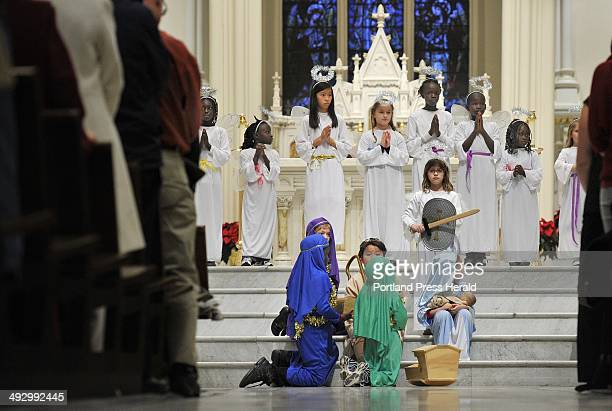 Children participate in a live nativity scene at Christmas Eve Mass at Cathedral of the Immaculate Conception Monday December 24 2012