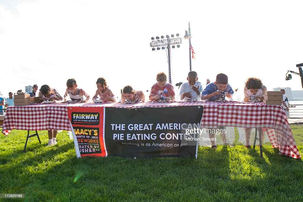 Children participate in a pie eating contest during the 37th annual Macy's 4th of July Fireworks over the Hudson River on July 4, 2013 in New York City.
