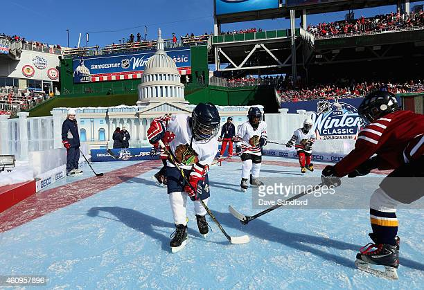 Children participate in a Youth Hockey game on an auxilary pond prior to the start of the 2015 Bridgestone NHL Winter Classic between the Washington...