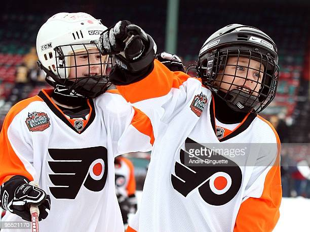 Children participate in a Youth Hockey game on an auxilary pond prior to the 2010 Bridgestone NHL Winter Classic at Fenway Park on January 1 2010 in...