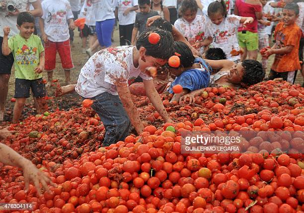 Children participate in the ninth annual tomato fight festival known as 'tomatina' in Sutamarchan Boyaca department Colombia on June 7 2015 AFP...