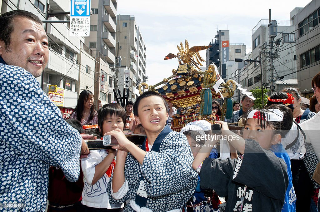 Children participate in the Sanja Matsuri festival at the Asakusa Shrine on May 19 2013 in Tokyo Japan Sanja Matsuri is considered one of the wildest...