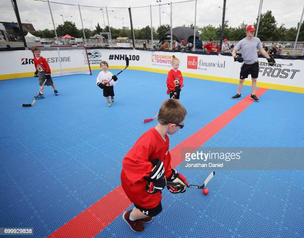 Children participate under the eye of Casey Mittelstadt during the 2017 NHL Draft top prospects hockey clinic and media availabilty at the United...