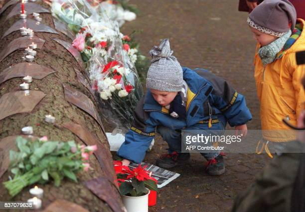 Children pay 29 November their respects to the victims of the 17 November Luxor terrorist attack in Egypt by leaving flowers alongside a specially...