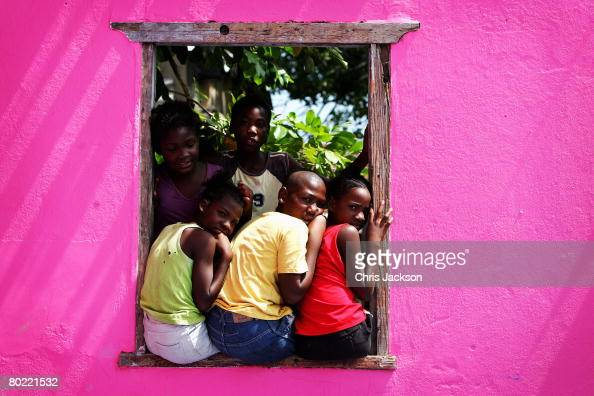 Children peer out of a window frame in Rose Town on March 12 2008 in Kingston Jamaica Kingston is currently a city with one of the highest crime...