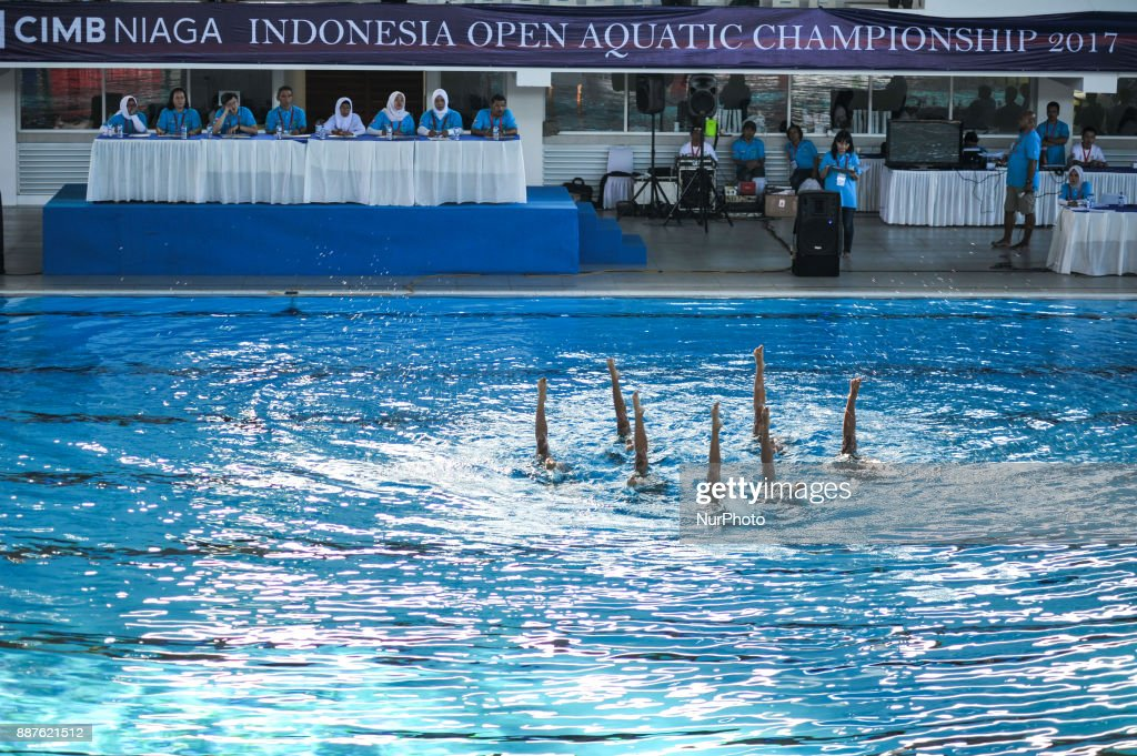 Children perform artistic swim in front of jury in Indonesia Open Aquatic Championship (IOAC) at the renovated Aquatics Stadium in Gelora Bung Karno sporting complex Senayan in Jakarta, Indonesia on December 7, 2017. IOAC held from 5 to 15 December 2017 by the Board of Indonesia's Pool Association (PBRSI) as part of test event before Asian Games 2018 venue.