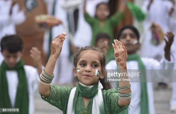 Children perform dance after Pakistan National flag hoisting ceremony during the Pakistan's Independence Day at Pakistan High Commission Embassy on...