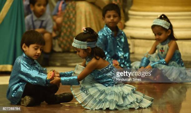 Children perform dance before tying rakhi to President Ram Nath Kovind and his wife Savita Kovind on the auspicious occasion of Raksha Bandhan at...