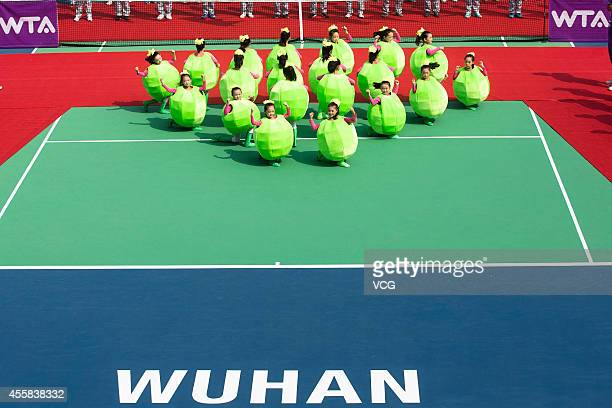 Children perform during the Opening Ceremony for the 2014 Dongfeng Motor Wuhan Open on September 21 2014 in Wuhan Hubei province of China