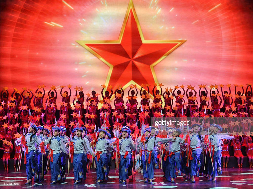 Children perform on stage singing 'red songs' to mark the 90th Anniversary Of The Communist Party Of China on June 29, 2011 in Chengdu, Suchuan Province of China. People from all over China celebrate together for the 90th anniversary of the founding of the Communist Party of China.