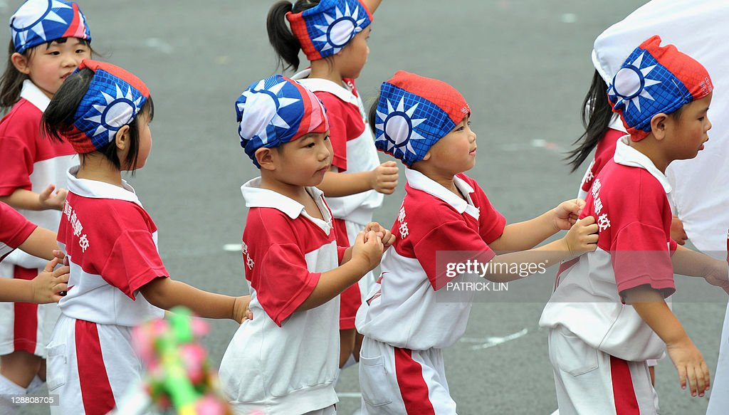 Children perform on the square in front of Taiwan's Presidential Office in Taipei at celebrations to mark the centenary of the revolution that set the stage for the Republic of China, island's official name, on October 10, 2011. Taiwanese President Ma Ying-jeou said that unification with China was not on the agenda for now, speaking a day after his Chinese counterpart called for the two rivals to reunite. AFP PHOTO / PATRICK LIN