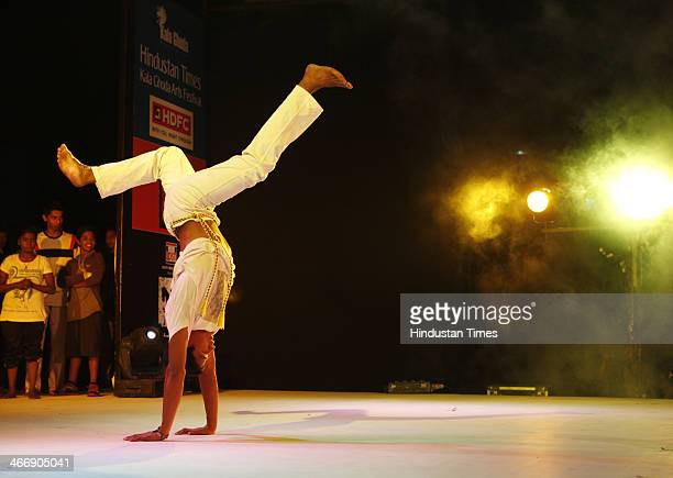 Children performing Capoeira which is a Brazilian martial art that combines elements of dance during the Kala Ghoda Arts on February 04 2013 in...