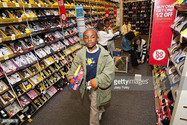 Children pick out their free shoes and try them on inside the store at Payless ShoeSource on November 20 2009 in Cincinnati Ohio