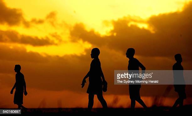Children play a game of soccer at sunset in the Fijian capital Suva 5 November 2006 SMH Picture by CHRIS LANE