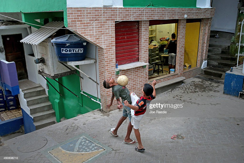 Children play a game of soccer in the streets of a 'favela' called Santa Marta on June 8, 2014 in Rio de Janeiro, Brazil. Brazil continues to prepare to host the World Cup which starts on June 12th and runs through July 13th.