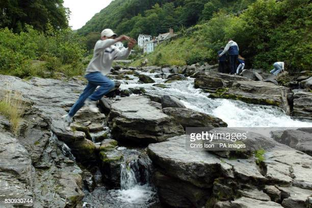 Children play along the East Lyn River in North Devon where 34 people died in flooding 50 years ago The Right Reverend Michael Langrish Bishop of...