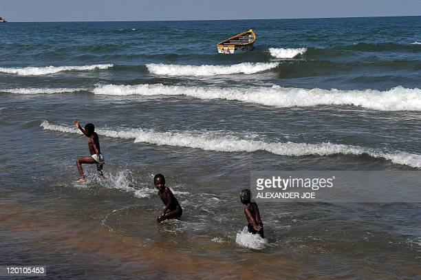 Children play along the Saga beach seaside at Lake Malawi on July 17 2011 Lake Malawi remains unspoilt and one of Malawi's' biggest tourist...