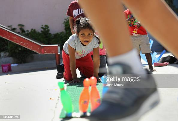Children play at a shelter for immigrant families on September 23 2016 in Tijuana Mexico The shelter run by Catholic nuns is part of the Coalicion...