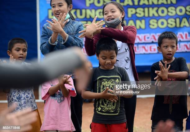 Children play at an evacuation centre in Klungkung regency on the Indonesian resort island of Bali on September 25 2017 Authorities have raised alert...