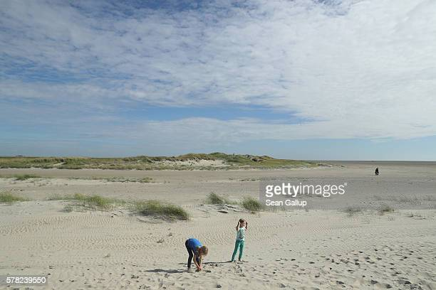 Children play at the beach on July 18 2016 at SanktPeterOrding Germany SanktPeterOrding is among the top destinations for vacationers along Germany's...