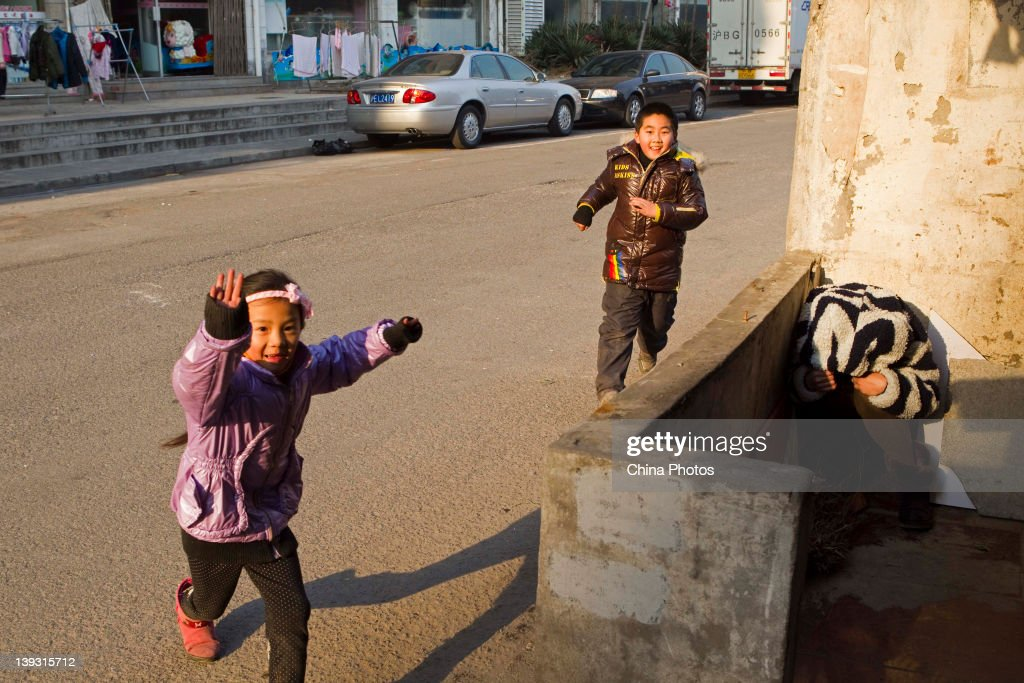 Children play at the North Bund on February 19, 2012 in Shanghai, China. According to local media, the North Bund area will be reconstructed as a international shipping and financial zone, a modern commercial and high-end residential area, and recreation center.