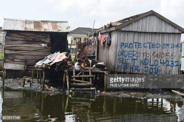 Children play at their makeshift home inscribed with a court order obtained to stop the authorities from demolishing shanty town Otodo Gbame...