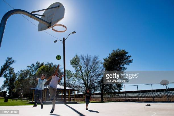 Children play basketball at Gadsden Park near the border fence for the US/Mexico border in Gadsden Arizona on February 15 2017 Attention Editors this...