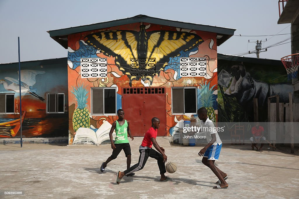 Children play basketball in front of a school, formerly an Ebola center, in the West Point slum on February 10, 2016 in Monrovia, Liberia. The school was cleaned and refurbished following the epidemic. West Point, the most impoverished and overpopulated community in Liberia, was hard hit by the Ebola outbreak. After almost two years, on January 14, 2016 the World Health Organization declared the epidemic over, after the virus had killed some 11,300 people and infected more than 28,500 people in West Africa.