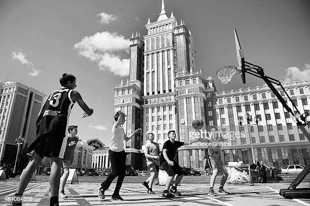 Children play basketball in Soviet Square during a media tour of Russia 2018 FIFA World Cup venues on July 17 2015 in Saransk Russia