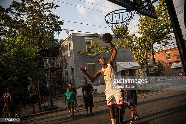Children play basketball in the street on August 20 2013 in the Whitman Park neighborhood of Camden New Jersey The town of Camden which was once a...