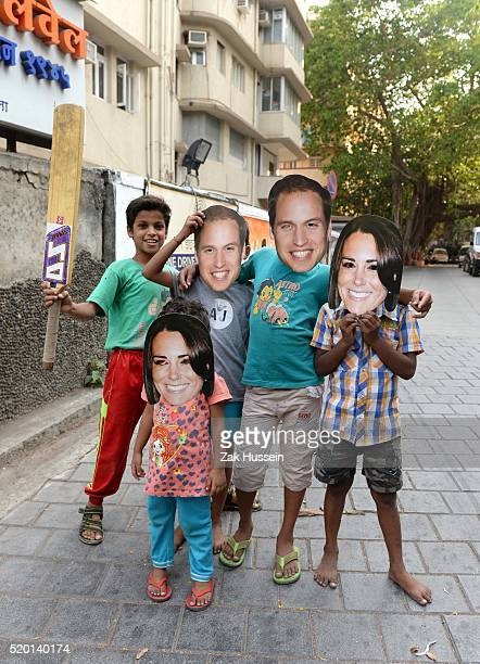 Children play cricket on the street wearing Prince William Duke of Cambridge and Catherine Duchess of Cambridge masks on April 10 2016 in Mumbai India