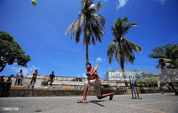 Children play cricket on the streets of Colombo on September 29 2012 in Colombo Sri Lanka